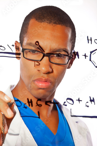 A young scientist works on a chemitsry equation
