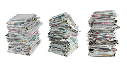 three different angle of stack of newspaper