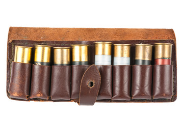 Leather bandolier with shotgun shells over white