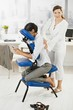 Businesswoman getting massage in office