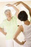 Senior woman with personal fitness trainer