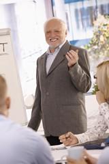 Portrait of senior businessman doing presentation