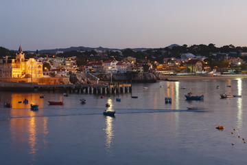 Coast and houses of Cascais at a dawn