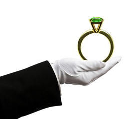 Butler holding emerald ring
