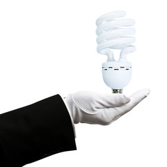 gloved hand holding light bulb