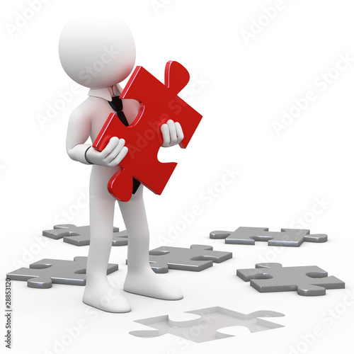 Man with a red puzzle piece in hand