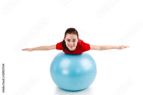 Girl exercising on white background