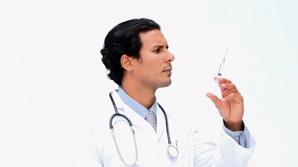 Doctor looking at an syringe