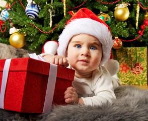 Santa baby playing with gift box
