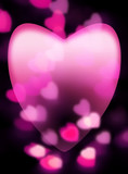 Pink heart fades into dark background with out-of-focus heart-sh