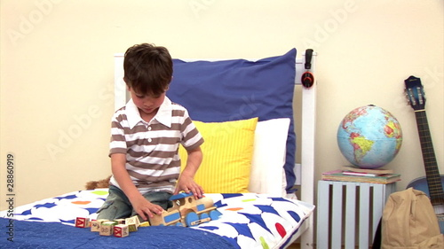 Animation of a little boy playing alone