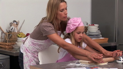 Beautiful woman preparing a meal with her daughter