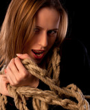 Playful young girl tied in ropes
