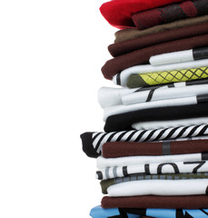 stack of colorful t-shirts. Clothes over white background