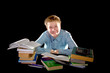 Pupil schoolboy with pile of textbooks