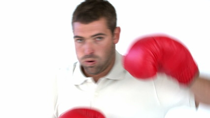 Charismatic man with boxing gloves