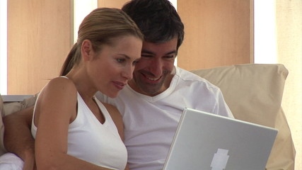 Concentrated couple surfing on the internet