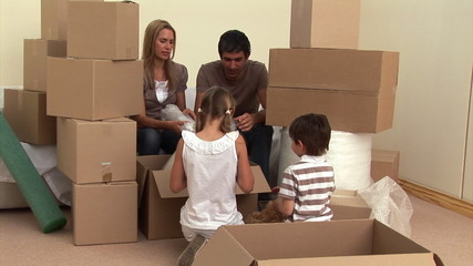 Animation of a family relaxing between boxes