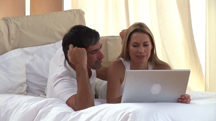 Cute couple surfing on the internet