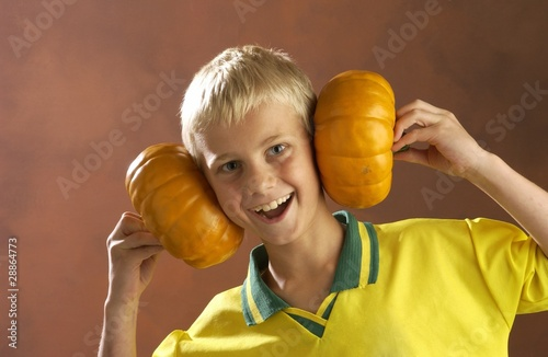 Boy Playing With Pumpkins
