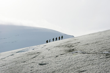 explorers in a glacier