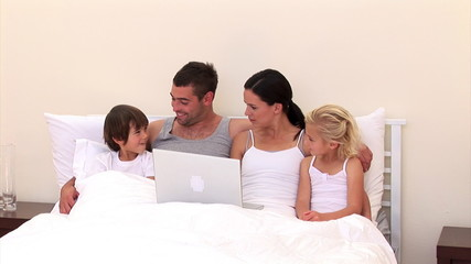 Adorable family surfing together on the web