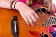 Girl Strumming Guitar