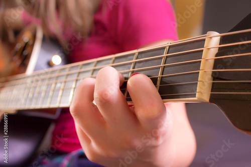 Girl's Hand on Guitar