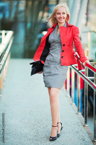 Young businesswoman on the stairs.