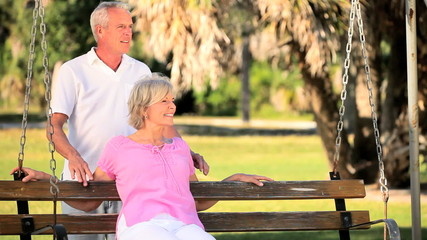 Healthy Retired Couple Relaxing at the Park