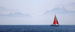 Yacht with a red sail on a mountain background - 28875338