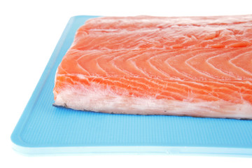 raw salmon fillet on blue plate