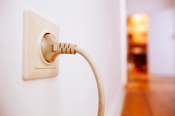 Plug connected to wall