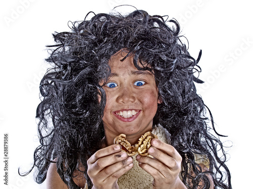 neanderthal child opening a cracked walnut - 28879386