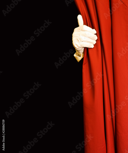 Magician behind red curtain