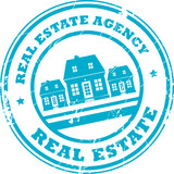Stamp with houses and the text real estate agency inside poster