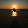 Somersault on beach in sunset at french atlantic coast