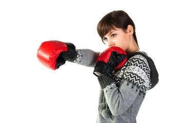 Beautiful girl in boxing gloves punching