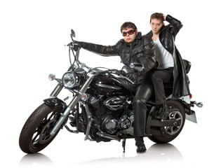 Couple in a black leather sitting on black custom motorcycle