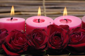 candlelight with rose on bamboo mat