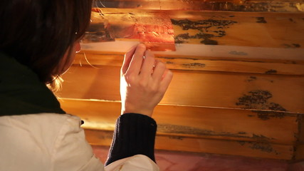 Woman is renovating the old piece of furniture.