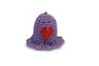 little knitted cap on a white background with a Heart