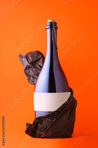 Black bottle of prosecco with blank label