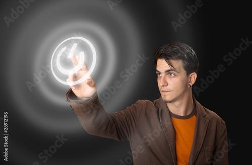 man pressing a touchscreen button