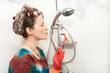 woman cleaning bathroom shower