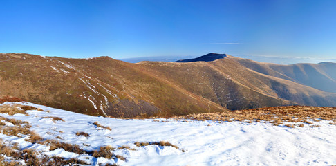 Mountain ridge and first snow panorama