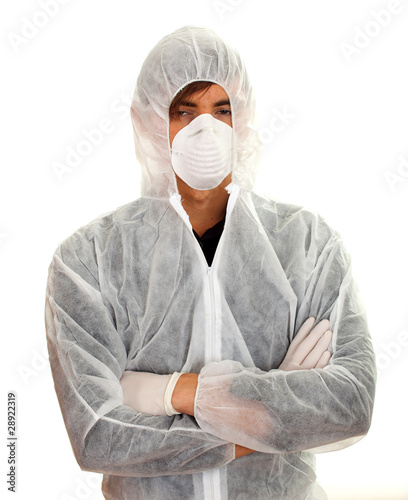 young man in white protective workwear and mask