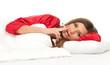 smoking woman in red pajamas lying in white bedding