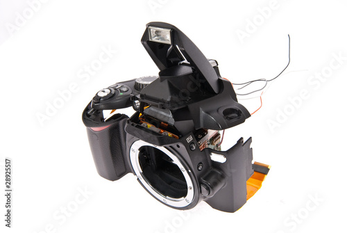 Broken and disassembled DSLR photocamera