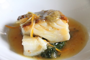 Cod fillet with vegetables and  sauce